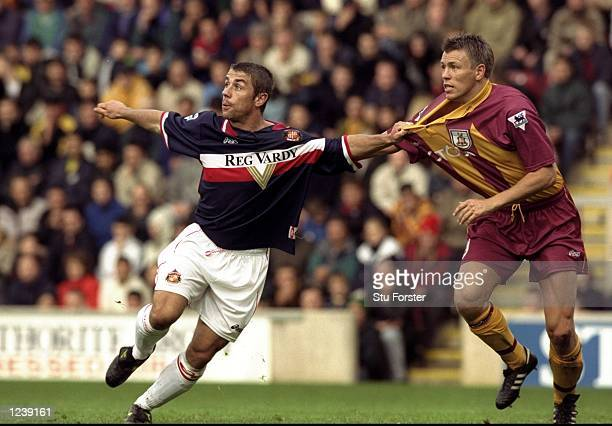 Kevin Phillips of Sunderland tuggs at the shirt of Gunnar Halle of Bradford during the FA Carling Premiership match played at Valley Parade in...