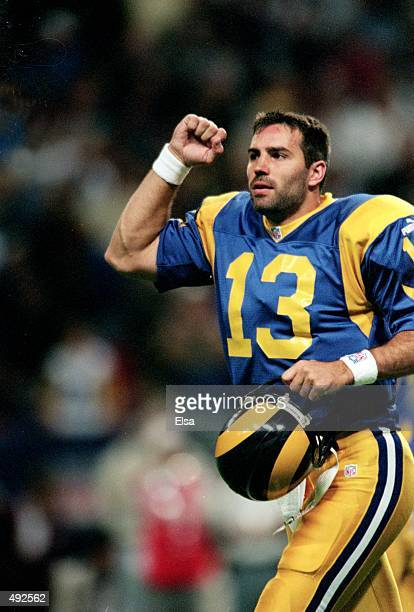 Kurt Warner of the St Louis Rams celebrates on the field during the game against Cleveland Browns at the Trans World Dome in St Louis Missouri The...