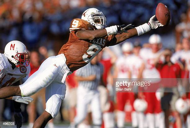 Kwame Cavil of the Texas Longhorns leaps to catch the ball during the game against the Nebraska Cornhuskers at the Texas Memorial Stadium in Austin...