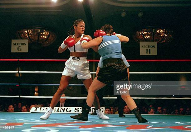 Laila Ali throws a left punch at April Fowler during the fight at the Turning Stone Casino in Verona New York Ali defeated Fowler by a KO in the...