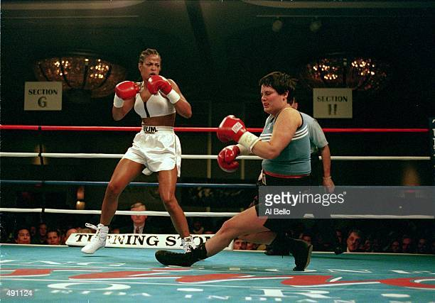 Laila Ali throws a punch at April Fowler as she falls during the fight at Turning Stone Casino in Verona New York Ali defeated Fowler by a KO in the...