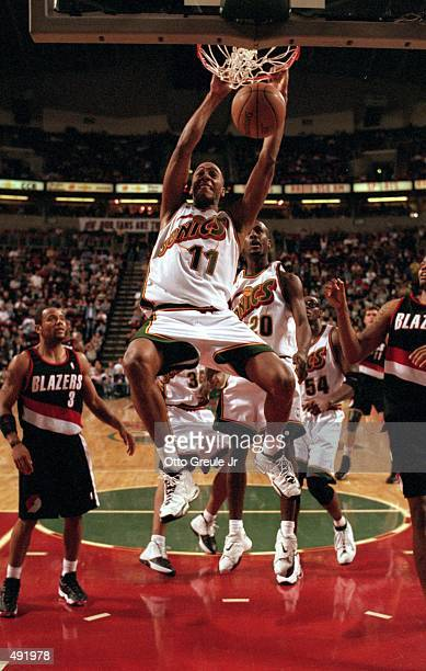 Lazaro Borrell of the Seattle SuperSonics makes a slam dunk during a game against the Portland TrailBlazers at the Key Arena in Seattle Washington...