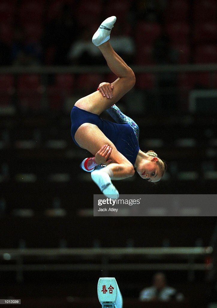 Lisa Mason of Great Britain jumps high during her balance beam routine in the qualifying round at the 1999 Tianjin World Gymnastics Championships, Tianjin, China. Mandatory Credit: Jack Atley/ALLSPORT