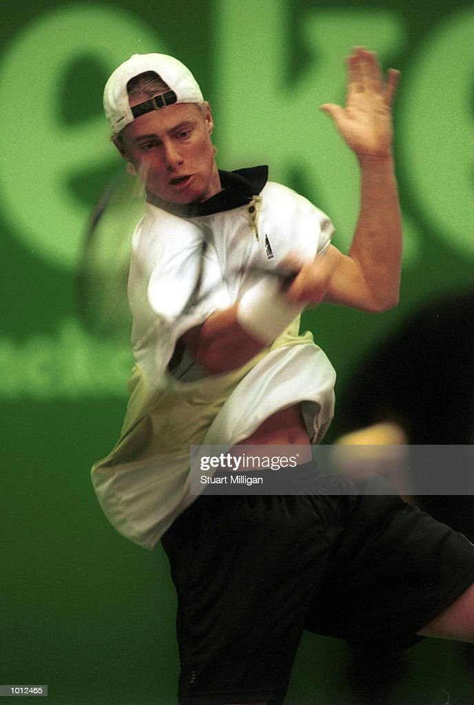 Lleyton Hewitt, of Australia hits a backhand during his match against Marcelo Rios, of Chile at the Heineken Singapore Tennis Open, played at the Singapore Indoor Stadium, Singapore. Rios won 7-5, 6-3 and advanced to the final. MandatoryCredit: Stuart Milligan/ALLSPORT