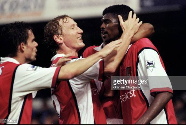 Marc Overmars and Ray Parlour congratulate Arsenal team mate Kwankwo Kanu on his second and equalising goal during the FA Carling Premier League...