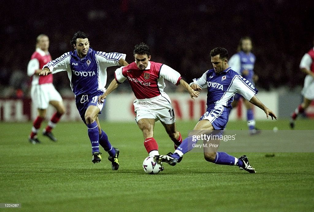 Marc Overmars of Arsenal takes on Fabio Rossitto (left) and Angelo Di Livio of Fiorentina during the UEFA European Champions League Group B match played at Wembley Stadium, London. The game finished in a 1-0 away win for Fiorentina and sawthe elimination of Arsenal from the second phase. \ Mandatory Credit: Gary Prior /Allsport