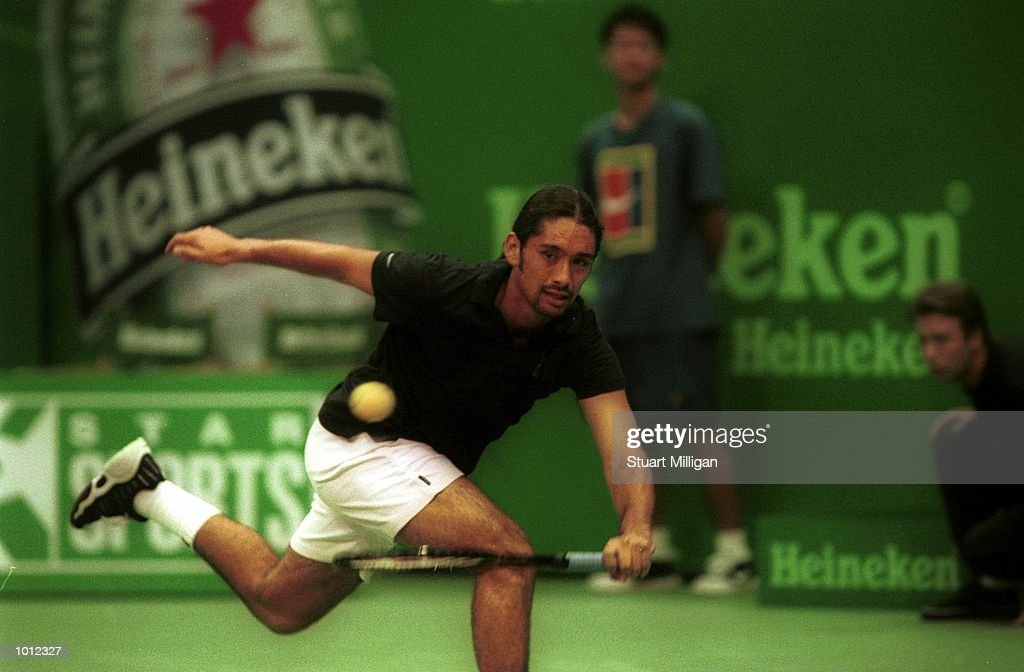 Marcelo Rios of Chile plays a forehand during his first round match against Fredrik Jonsson, of Sweden during the Heineken Singapore Tennis Open, played at the Singapore Indoor Stadium, Singapore. Rios defeated Jonnson. Mandatory Credit:Stuart Milligan/ALLSPORT