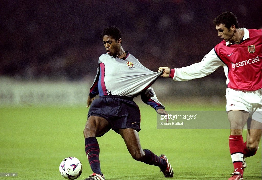 Martin Keown of Arsenal tugs the shirt of Barcelona's Patrick Kluivert during the Champions League Group B match played at Wembley Stadium, London. The game finished in a 4-2 win for Barcelona. \ Mandatory Credit: Shaun Botterill /Allsport