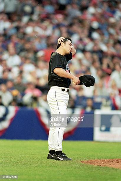 Masato Yoshii of the New York Mets fixes his hat in the infield during the NLCS game four against the Atlanta Braves at Shea Stadium in Flushing New...