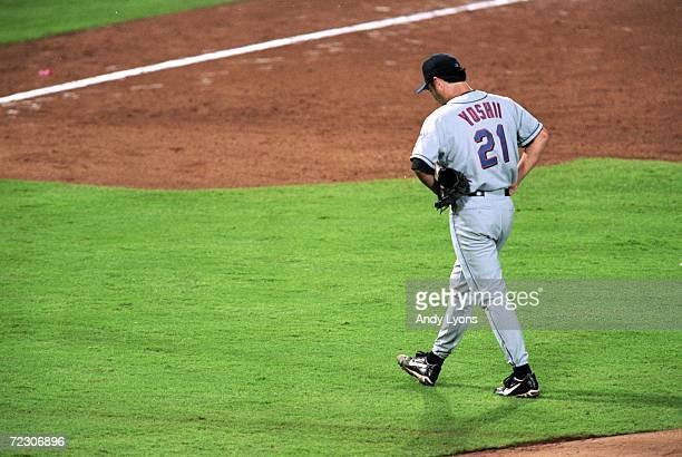 Masato Yoshii of the New York Mets walks on the field during the National League Championship Series game one against the Atlanta Braves at Turner...