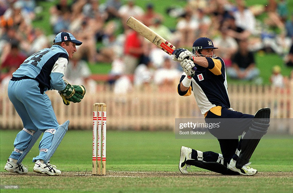 Matthew Elliott of the Victorian Bushrangers hits through mid wicket as NSW Blues wicketkeeper Brad Haddin looks on during the Mercantile Mutual Cup at the North Sydney Oval, Sydney, Australia. Mandatory Credit: Scott Barbour/ALLSPORT