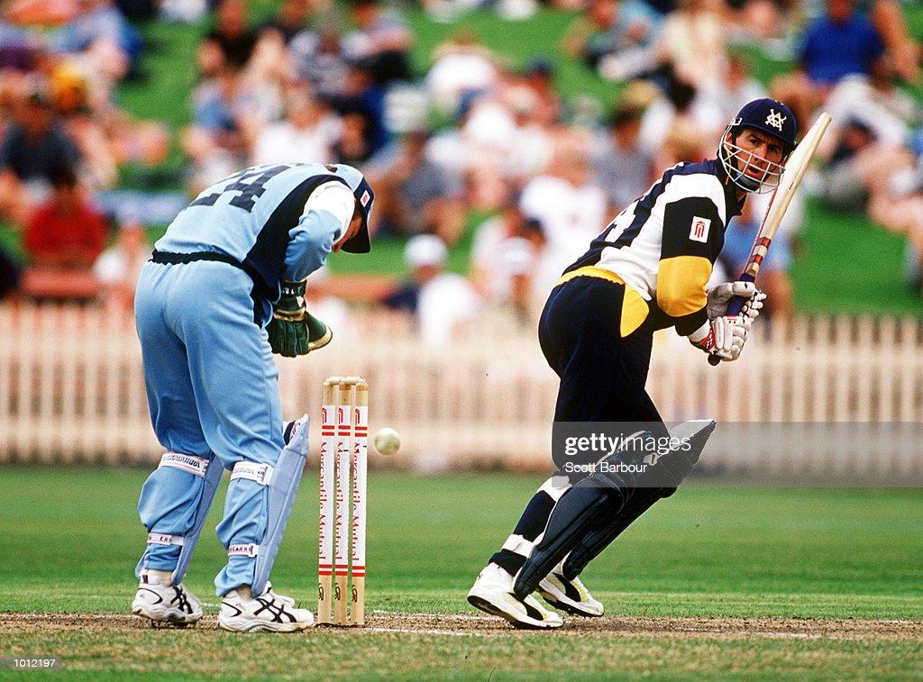 Matthew Elliott of the Victorian Bushrangers leg glances as NSW Blues wicketkeeper Brad Haddin looks on during the Mercantile Mutual Cup at the North Sydney Oval, Sydney, Australia. Mandatory Credit: Scott Barbour/ALLSPORT