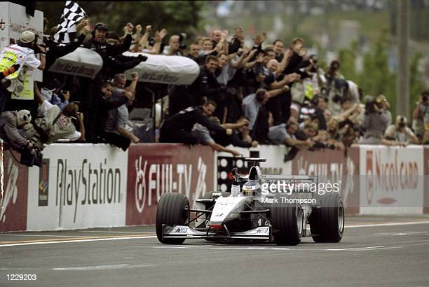 McLaren Mercedes driver Mika Hakkinen takes the chequered flag to win the Formula One Japanese Grand Prix and clinch a second successive World...