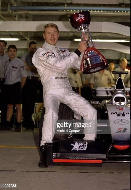 McLaren Mercedes driver Mika Hakkinen wins the Formula One Japanese Grand Prix to clinch a second successive World Championship at Suzuka in Japan. \...
