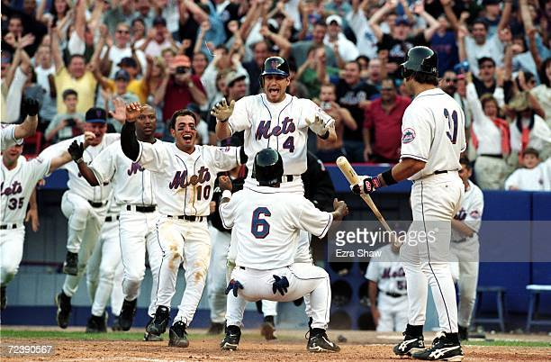 Melvin Mora of the New York Mets celebrates after scoring the winning run during the game against the Pittsburgh Pirates at Shea Stadium in Flushing...