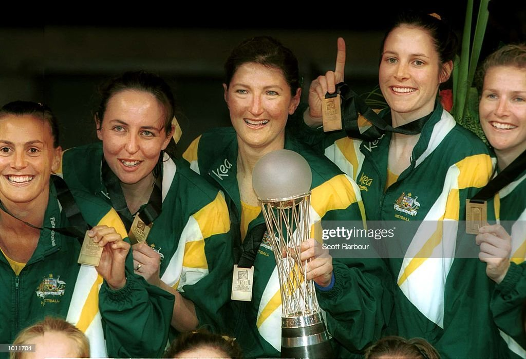 Members of the Australian team with captain Vicki Wilson (centre) holding the trophy after winning the Final of the 1999 World Netball Championships held at the WestPac Trust Centre, Christchurch, New Zealand. Australia defeated New Zealand 42-41. Mandatory Credit: Scott Barbour/ALLSPORT