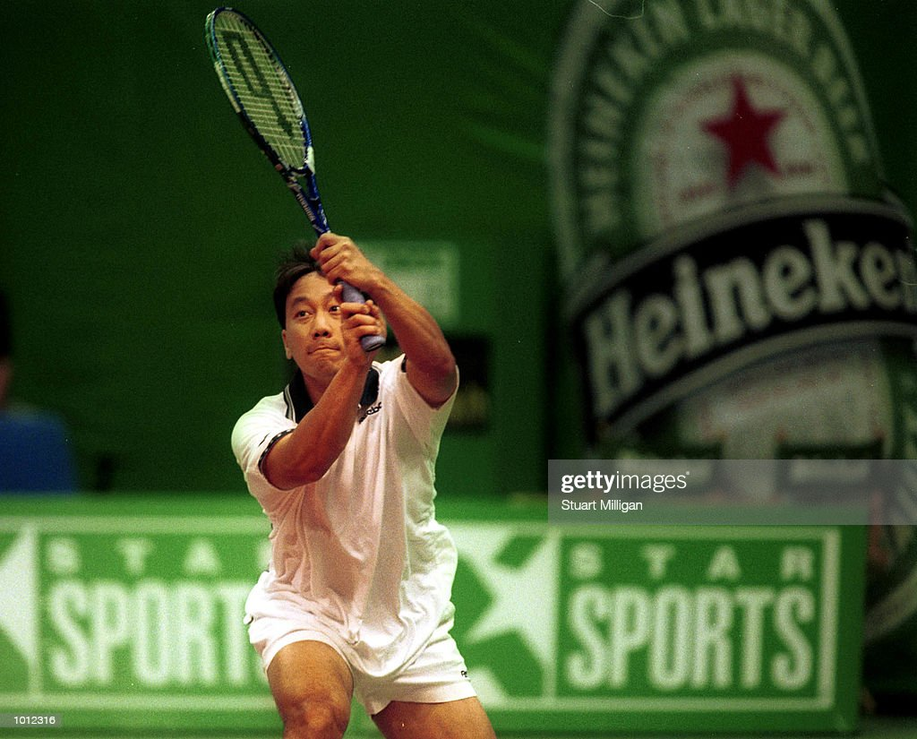 Michael Chang of the USA plays a backhand during his first round match against Leander Paes of India during the Heineken Singapore Tennis Open played at the Singapore Indoor Stadium, Singapore. Chang won 6-1 6-3. Mandatory Credit: StuartMilligan/ALLSPORT