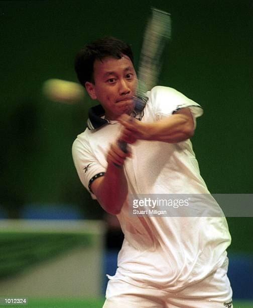 Michael Chang of the USA plays a backhand during his first round match against Leander Paes of India during the Heineken Singapore Tennis Open,...