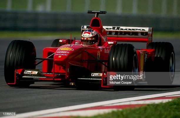Michael Schumacher of Germany and Ferrari in action during the Malaysian Formula One Grand Prix at Sepang Kuala Lumpur Malaysia Mandatory Credit...