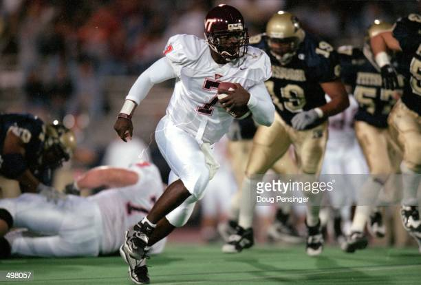 Michael Vick of the Virginia Tech Hokies carries the ball during the game against the Pittsburgh Panthers at the Pittsburgh Stadium in Pittsburgh...