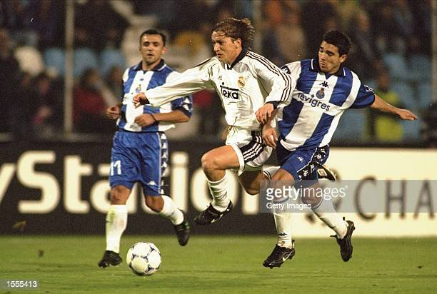 Michel Salgado of Real Madrid is tackled by the Porto defence during the Champions League match played at the Estadio Das Antas in Oporto, Portugal....