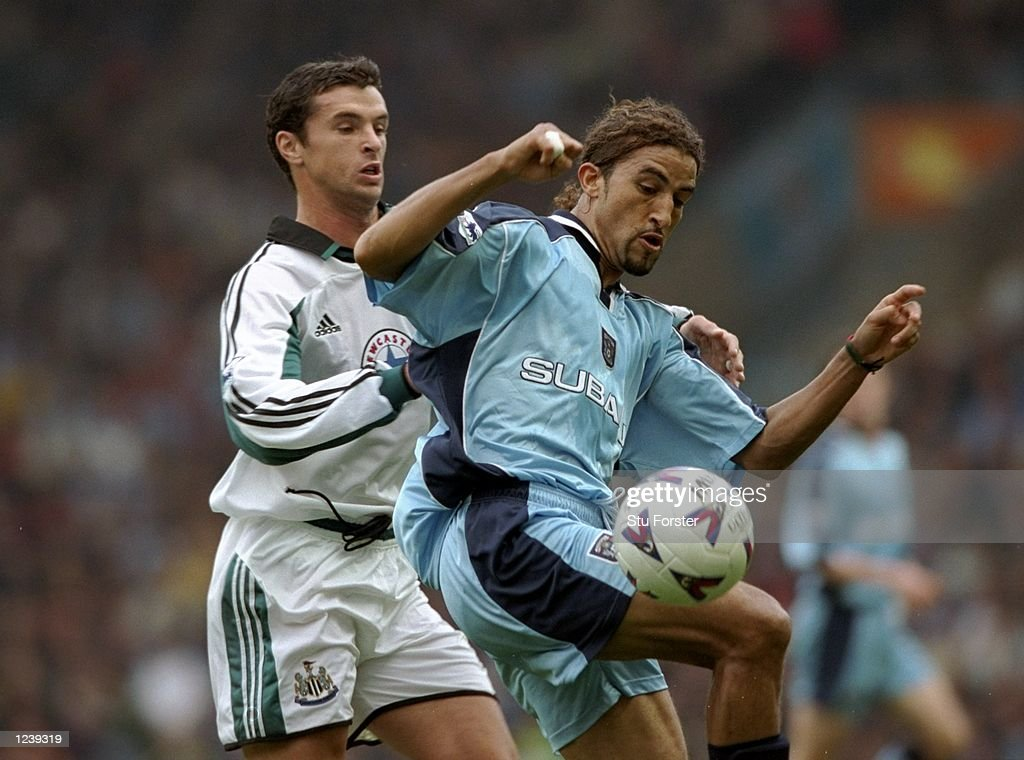 Mustapha Hadji of Coventry   Gary Spead od Newcastle : News Photo