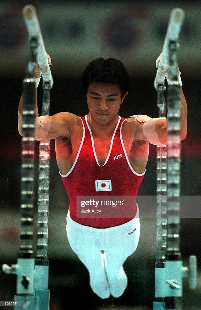 Mutsumi Harada of Japan performs on the horizontal bars during the mens teams final at the 1999 Tianjin World Gymnastics Championships, Tianjin, China. Japan finished in fourth place overall. Mandatory Credit: Jack Atley/ALLSPORT
