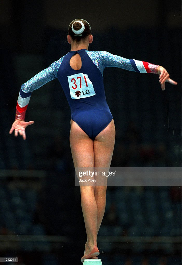 Natalie Lucitt of Great Britain fights for balance during her balance beam routine in the qualifying round at the 1999 Tianjin World Gymnastics Championships, Tianjin, China. Mandatory Credit: Jack Atley/ALLSPORT