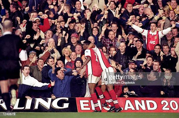 Nwankwo Kanu and Thierry Henry of Arsenal celebrate Kanu's 90th minute winner during the FA Carling Premier League match against Chelsea played at...