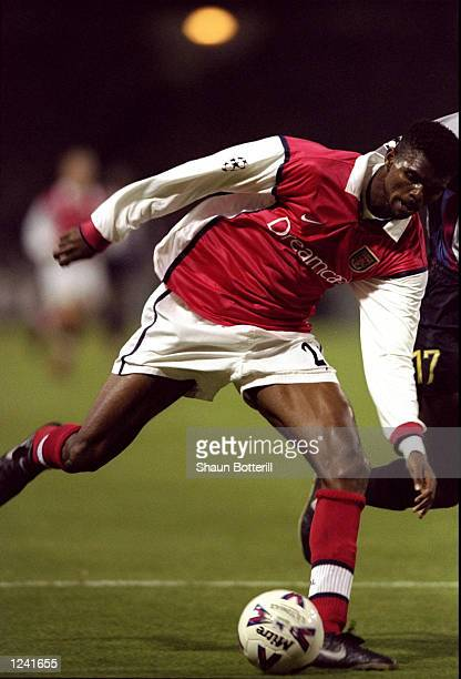 Nwankwo Kanu of Arsenal in action during the UEFA Champions League Group B match against Barcelona played at Wembley Stadium London The game finished...