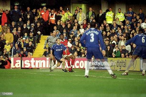 Nwankwo Kanu of Arsenal scores a dramatic 90th minute winning goal from an acute angle during the FA Carling Premier League match against Chelsea...