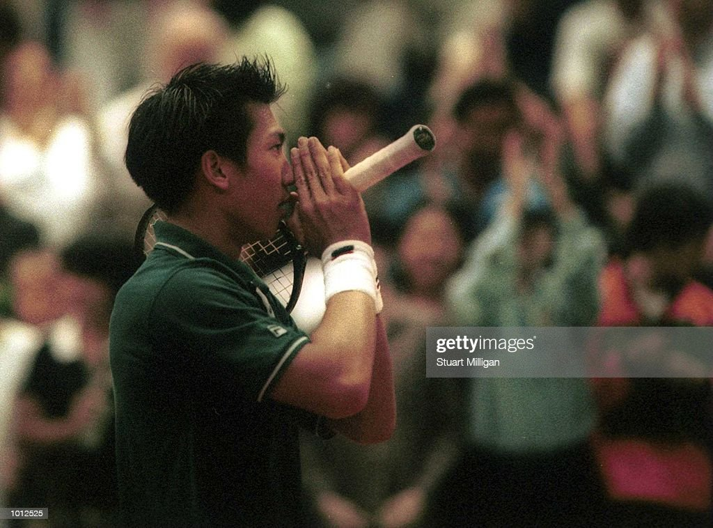 Paradon Srichaphan of Thailand prays after his victory against Andrew Ilie of Australia at the Heineken Singapore Tennis Open, played at the Singapore Indoor Stadium, Singapore. Srichaphan won and advanced to the semi finals. Mandatory Credit: Stuart Milligan/ALLSPORT