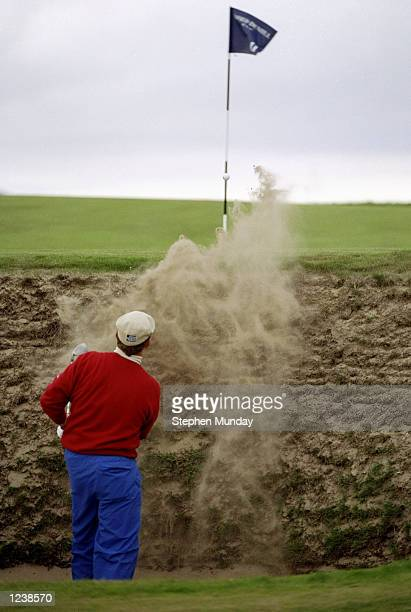 Payne Stewart of the USA plays out of a deep bunker on the 11th hole during the Alfred Dunhill Cup played at The Old Course St Andrews Scotland...
