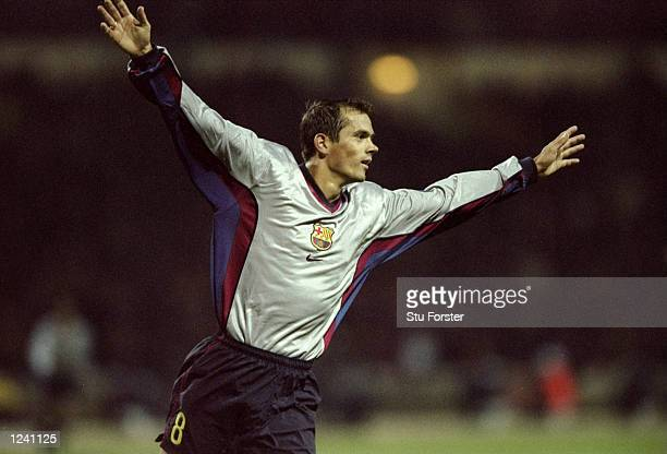Phillip Cocu of Barcelona scores the fourth goal in the 69th minute during the Champions League Group B match against Arsenal played at Wembley...