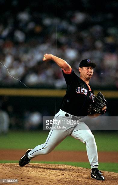 Pitcher Masato Yoshii of the New York Mets winds up for the pitch during the game against the Arizona Diamondbacks at the Bank One Ballpark in...
