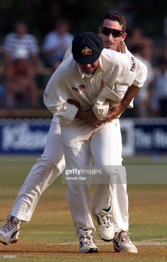 Ricky Ponting (front) and Damien Fleming of Australia, wrestle as they leave the field at the end of Zimbabwe's 2nd innings, during day four of the one off test match between Zimbabwe and Australia at Harare Sports Club, Harare, Zimbabwe.Australia won by 10 wickets.X Mandatory Credit: Hamish Blair/ALLSPORT