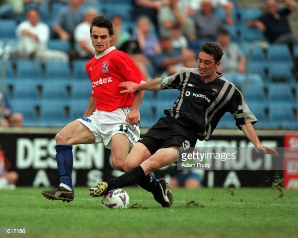 Riki Van Steeden of the Kingz and Tom Pondeljak of United fight for the ball during the match between Sydney United v Auckland Kingz at the Sydney...