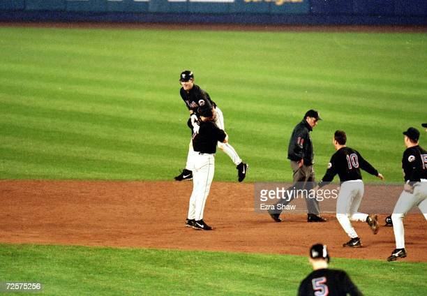 Robin Ventura of the New York Mets celebrates the game winning home run as he runs the bases during the National League Championship Series game four...