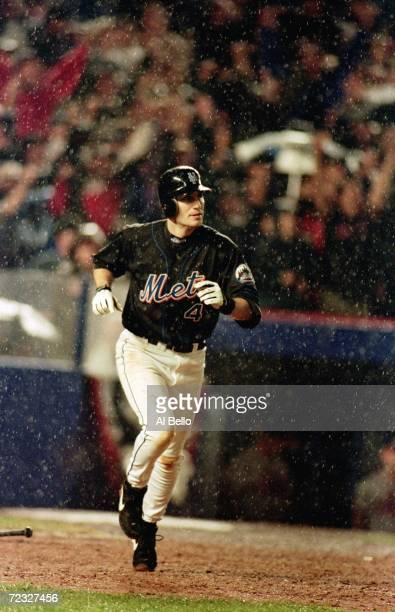 Robin Ventura of the New York Mets runs the bases after making a home run during the National League Championship Series game four against the...