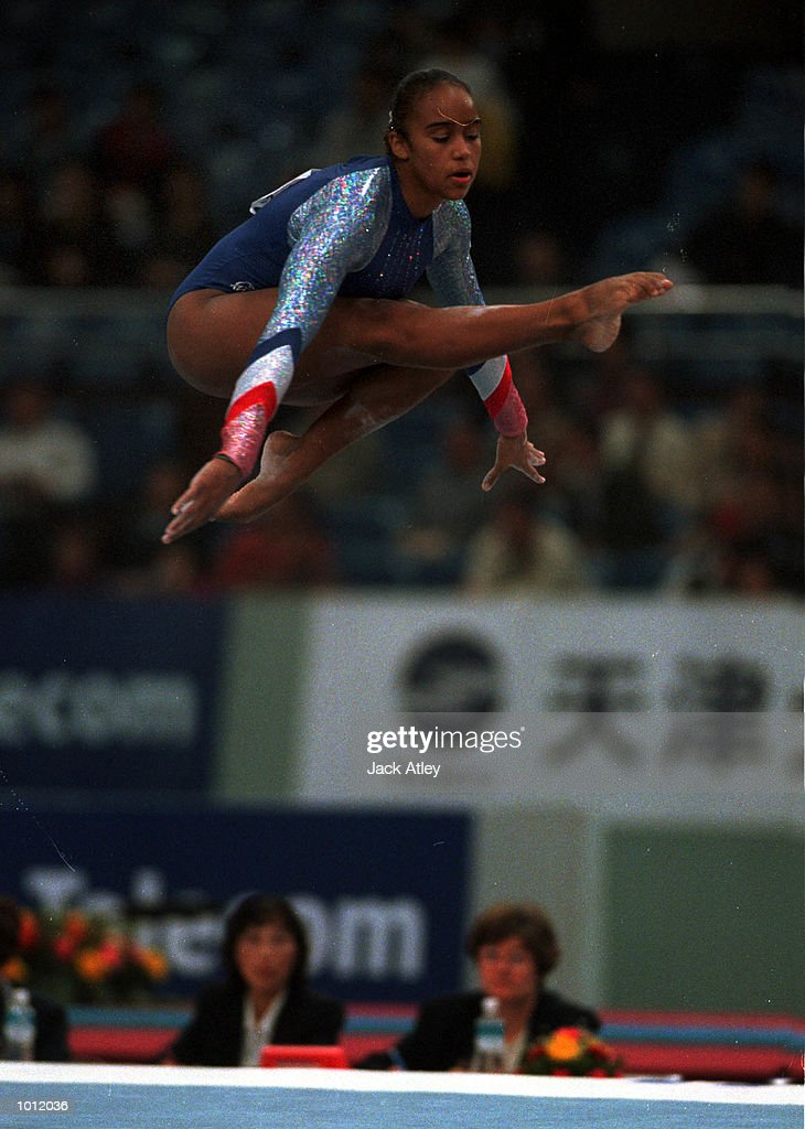 Rochelle Douglas of Great Britain jumps high during her floor routine in the qualifying round at the 1999 Tianjin World Gymnastics Championships, Tianjin, China. Mandatory Credit: Jack Atley/ALLSPORT