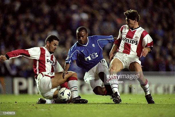 Rod Wallace of Rangers takes on Yuri Nikiforov and Jan Heintze of PSV Eindhoven in the UEFA Champions League Group F match at Ibrox in Glasgow...