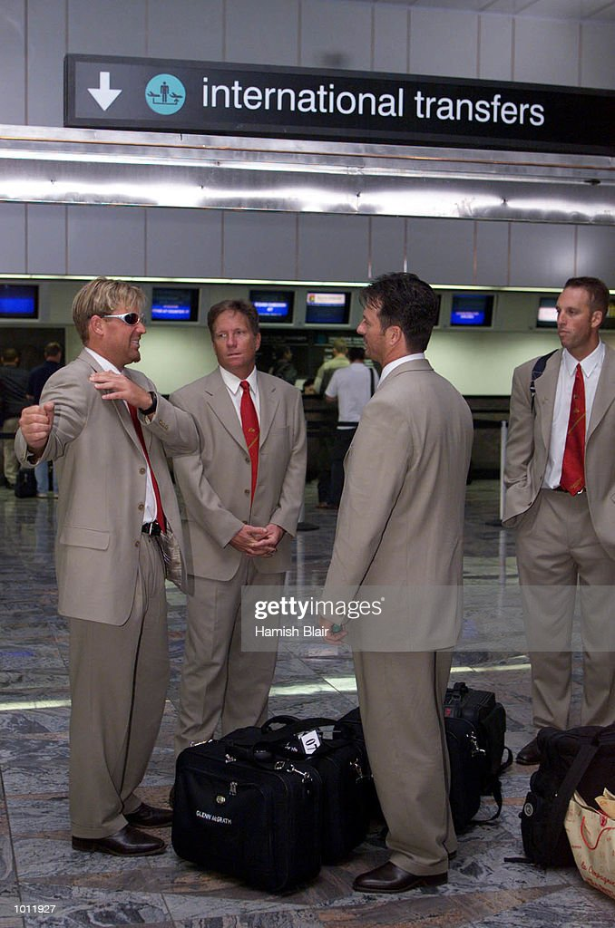 Shane Warne of Australia, stretches out while chatting with Ian Healy, Steve Waugh and fitness advisor David Misson, as the team arrive in Johannesburg from Colombo via Hong Kong on the way to Zimbabwe. Mandatory Credit: Hamish Blair/ALLSPORT