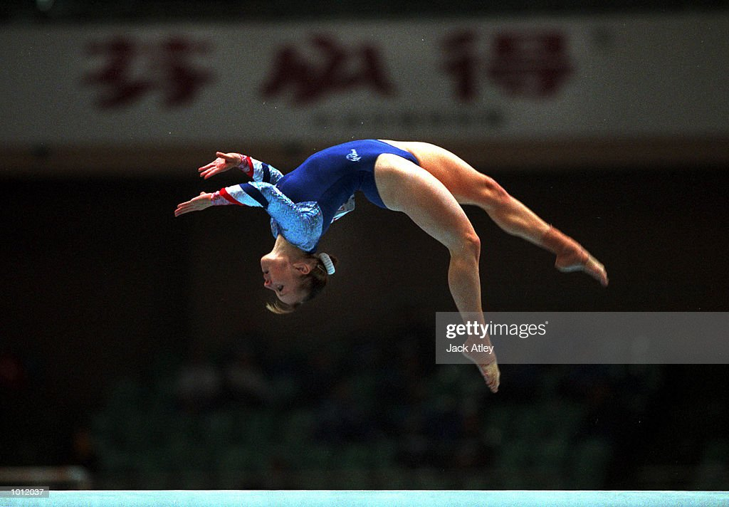 Sharna Murray of Great Britain jumps during her balance beam routine in the qualifying round at the 1999 Tianjin World Gymnastics Championships, Tianjin, China. Mandatory Credit: Jack Atley/ALLSPORT