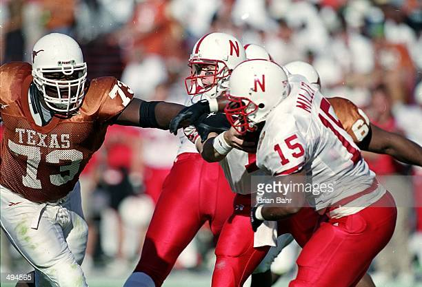 Shaun Rogers of the Texas Longhorns tries to block a pass to Willie Miller of the Nebraska Cornhuskers during the game at the Texas Memorial Stadium...