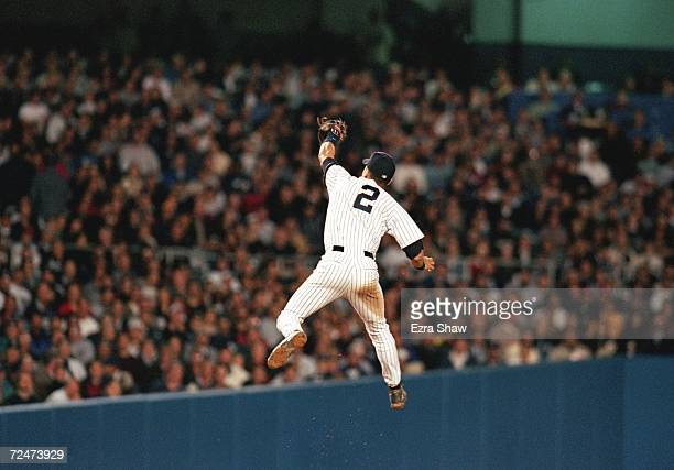 Shortstop Derek Jeter of the New York Yankees jumps to make a catch against the Boston Red Sox during game 1 of the American League Championship...