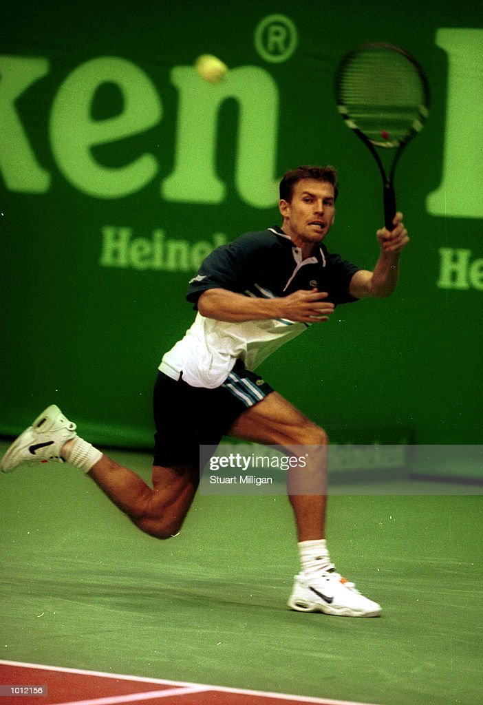 Stephane Huet, of France plays a forehand during his first round match against Nicklas Kulti, of Sweeden in the Heineken, Singapore Tennis Open, played at the Singapore Indoor Stadium, Singapore . Huet defeated Kulti, 7-5, 6-4 Mandatory Credit: Stuart Milligan/ALLSPORT