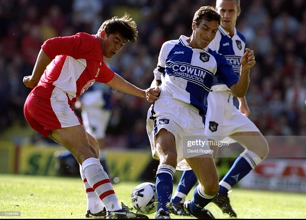 Steve Jones of Bristol City is challenged by Andy Tilson of Bristol Rovers during the Nationwide Division Two match at Ashton Gate in Bristol, England. The game ended goalless. \ Mandatory Credit: David Rogers /Allsport