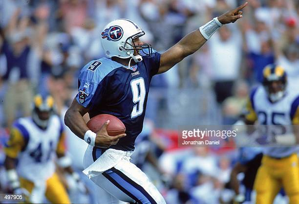 Steve McNair of the Nashville Titans points as he runs with the ball during a game against the St. Louis Rams at the Adelphia Coliseum in Nashville,...