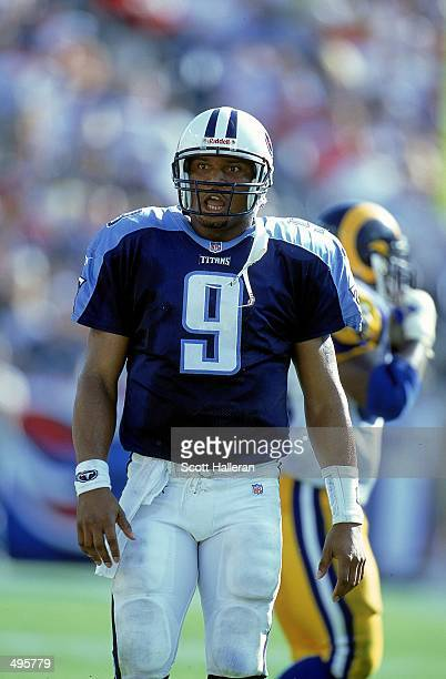Steve McNair of the Nashville Titans walks on the field during a game against the St Louis Rams at the Adelphia Coliseum in Nashville Tennessee The...