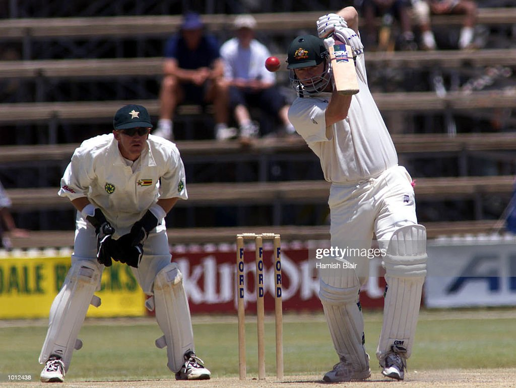 Steve Waugh of Australia drives with Andy Flower of Zimbabwe looking on, during day three of the one off test match between Zimbabwe and Australia at Harare Sports Club, Harare, Zimbabwe.X Mandatory Credit: Hamish Blair/ALLSPORT